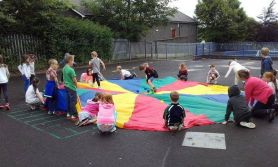 Primary Three Enjoying Parachute Games On Our 80th Anniversary Fun Day
