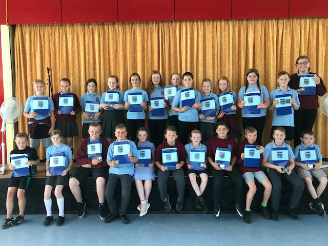 Our Primary Seven Class with their Leavers Folders and their commemorative medal of the Royal Wedding (thanks to Antrim & Newtownabbey Council)